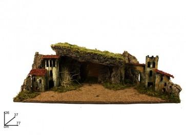 Paesaggio di natale con grotta e torri addobbi natale